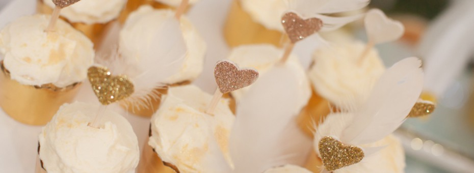 Glittered hearts and feathers cupcake toppers - Love The Occasion